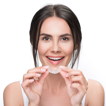 Woman holding a invisalign braces