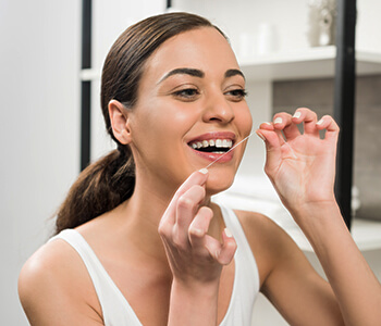 Brushing, Flossing, and Oil Pulling Can Help at Dr. Beata Calrson of Natural & Cosmetic Dentistry in Clearwater Area