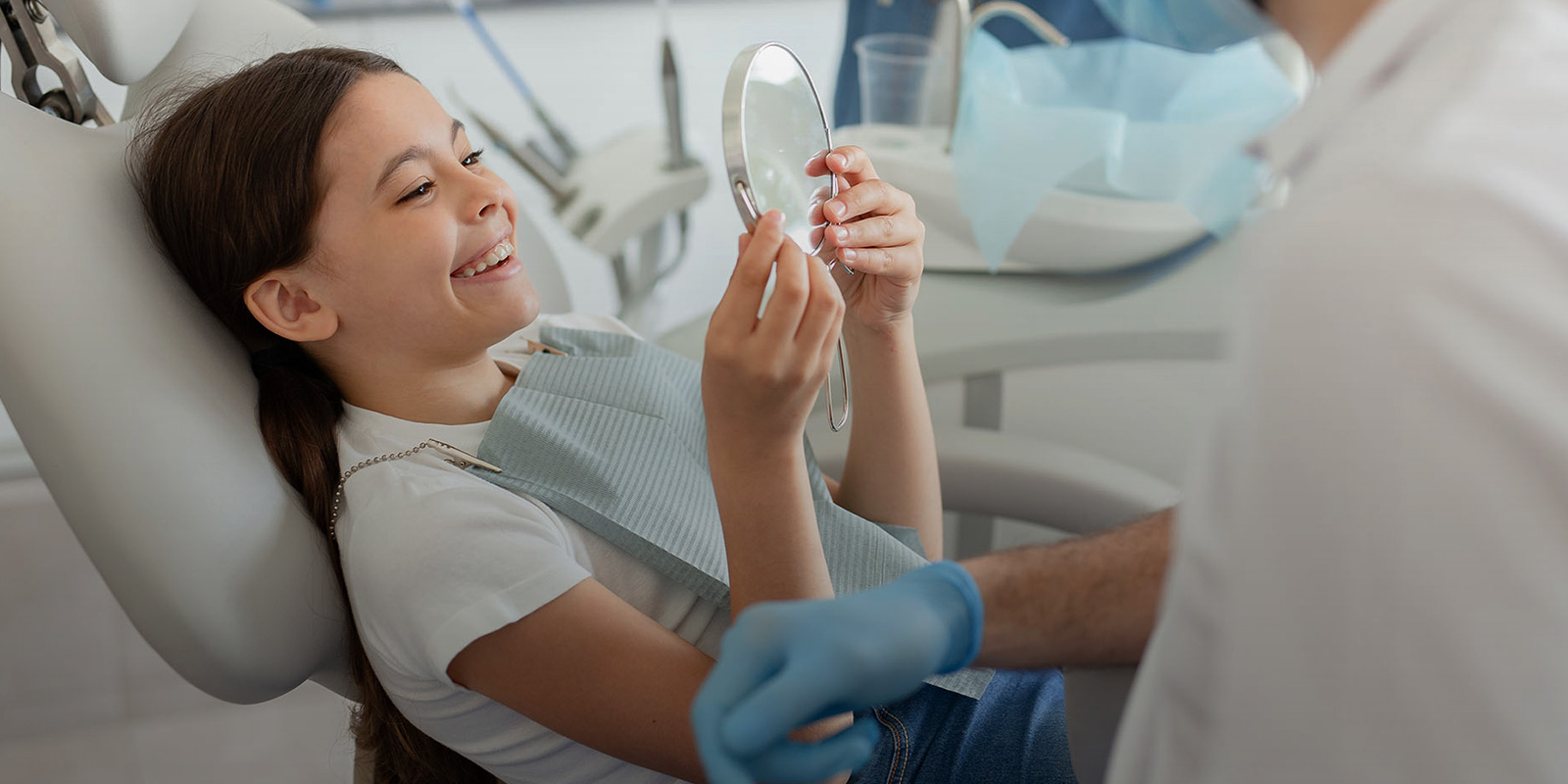 Meet Our Holistic Dentists Woman in dental office
